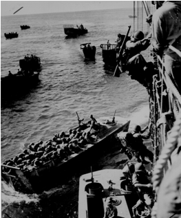 U.S. troops go over the side of a Coast Guard manned combat transport